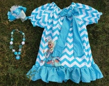 Frozen outfit. Price includes dress, bow  AND chunky necklace. Please message me for available sizes.
