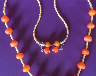 Frosted marderine glass beaded necklace with matching earrings.