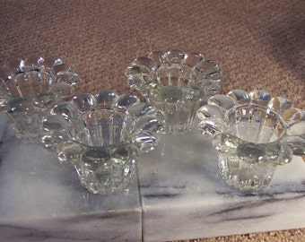 4 glass flower shaped candle holders
