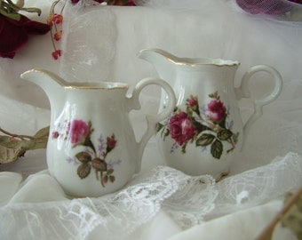 2 small red rose creamers milk jugs