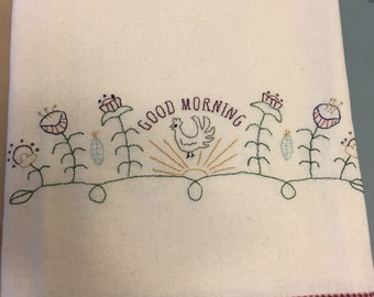 Hand embroidered tea towels with trim.