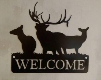 Deer and elk welcome sign