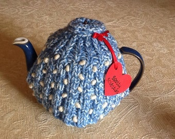 Knitted blue, ribbed tea cosy