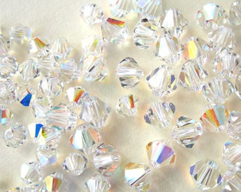 Pack of 50 Swarovski XILION bicone beads in crystal AB (Aurora Borealis)