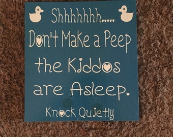 Large sign kiddos sleeping