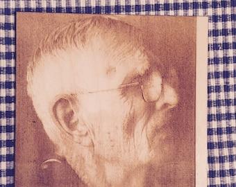 Laser etched photographs