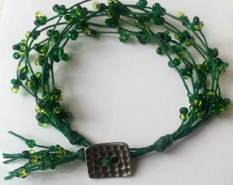 Green knotted beaded bracelet