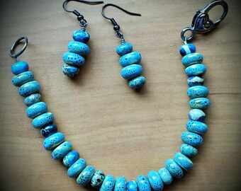 Bracelet made of turquoise colored beads with matching earrings; sterling silver wire and clasp