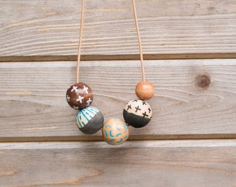 Hand Painted Wooden Bead Necklace in September Sky,  Anna Joyce, Portland, OR.