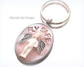 Fly Safe Frozen Charlotte Doll Keychain Guardian Travel Angel Mixed Media