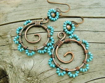 Bead Dance - wire wrapped antiqued copper hoops with seed beaded petals in Aqua