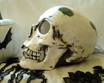 Ceramic Skull with black smudges and everchanging color LED bulb