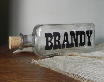 Vintage bar bottle with graphics - mad men Brandy black letters with cork lid