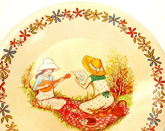 70's tin toy tea plate with Holly Hobbie style pattern.