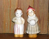 Vintage German Bisque Girl with hand muff and Boy with Side Glanced Eyes Couple Frozen Charlotte Figurines marked Germany
