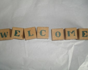 Decorative Birch Blocks say WELCOME