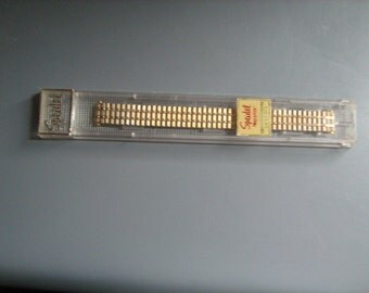 1960s  new old stock speidel gold finish men's twist - o- flex watch band retail for 16.95 back in the day
