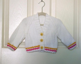 Knitted White Baby Cardigan with Bright Pink and Gold Trim and Sun Buttons