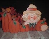 Sammy Scarecrow with Pumpkins