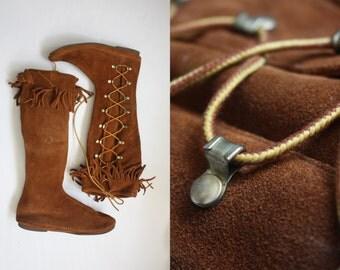 minnetonka lace up boots / size 10