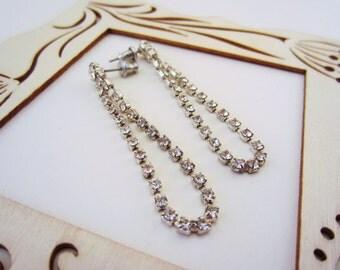 Vintage rhinestone teardrop dangle earrings. Great for a bride, wedding, special treat. Silver and rhinestone sparkle earrings
