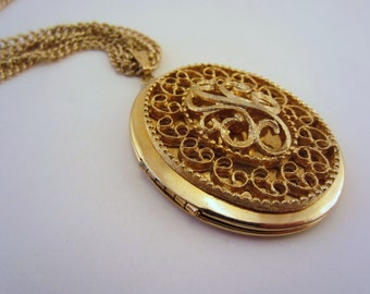 Vintage locket necklace. Sarah Coventry locket. Three-strand upcycled chain necklace. Long necklace. Filigree detail.