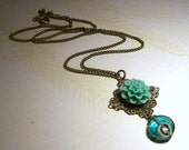 Turquoise Dahlia with Peacock Feather Foil Glass Bead Dangle Necklace in Antique silver