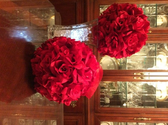 Red roses flower ball centerpiece and kissing by welovewreaths