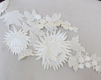 Cute venice applique  ivory color 1 pieces listing 13 inches long 6 1/2 inches wide at the widest part