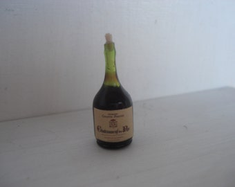 Miniature red wine glass bottle