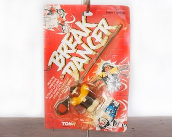 Vintage Tomy Break Dancer gyroscopic spinning top toy, hard plastic, 1980s, 1984, Boog-a-Loo Shoe, break dancing figure with card, rip cord