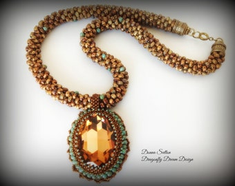 "This stunning 24"" necklace and pendant has just a taste of fall in its color combination. The pendant glows like the sun on a crisp fall day"