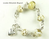 Bracelet of beige and Cream Lampwork Beads