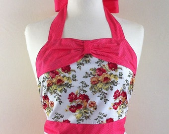 Retro apron with bow, orange floral pattern on a white fabric,  1950s inspired, fully lined.