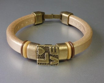 Extra thick golden leather bracelet with bronze clasp - licorice leather bracelet with Oh rings