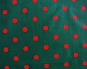 Vintage 1970s fabric in highquality unused cotton with orangered printed dot pattern on dark forest green bottomcolor