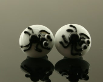 Set of 2 glass lampwork black spider buttons