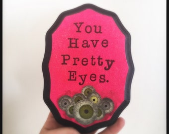 You Have Pretty Eyes art wall plaque