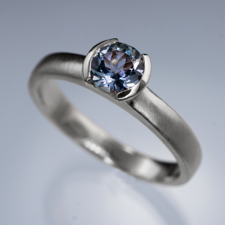 round tanzanite half bezel solitaire tanzanite wedding rings zoom