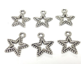 6 silver plated stars