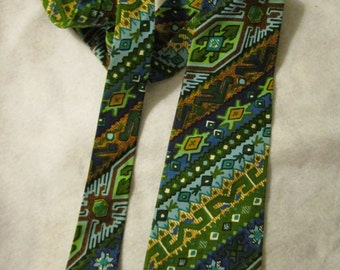 1960s NECKTIE in Abstract Multi-Color Print by COURTLEY