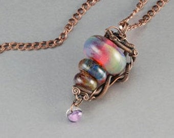 Wire Wrapped Lampwork bead Pendant.