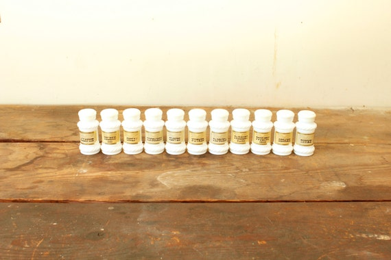 Small vintage white glass jars