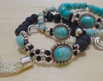 White and Blue-Green Beaded Bracelet with Circular Silver and Turquoise Charm and Silver Moon Pendants