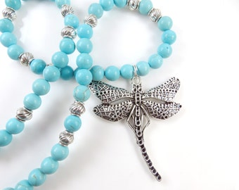 Dragonfly with turquoise necklace