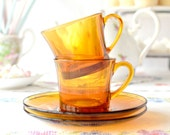 Set of 2 amber glass cups and saucers by Duralex France: pair of vintage coffee / tea cups and saucers
