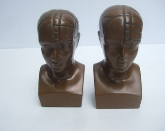 Unique Diminutive Pair of Cranium Statues