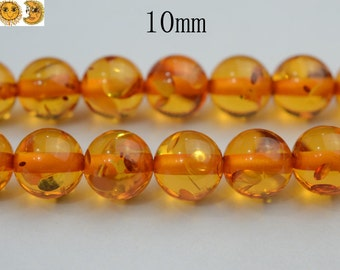 15 inch strand of Synthetic Amber smooth round beads 10 mm