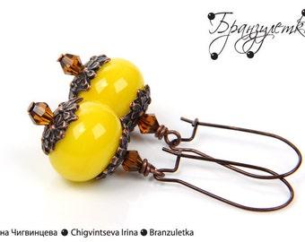 Earrings Sun with lampwork beads yellow copper