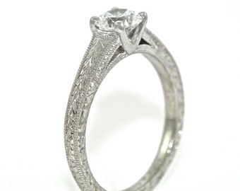 Platinum and Diamond Solitaire Hand Engraved Engagement Ring with .54ct Moissanite